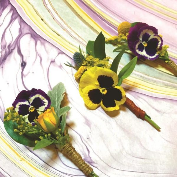 Boutonnieres made out of pansies for the fall and spring