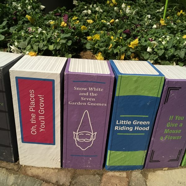 Clever retaining wall made to look like books at the Chicago Flower & Garden Show - National Garden Bureau
